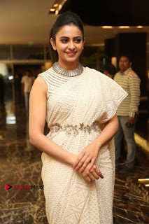 Actress Rakul Preet Singh Stills in White Dress at Winner Pre Release Function  0022.jpg