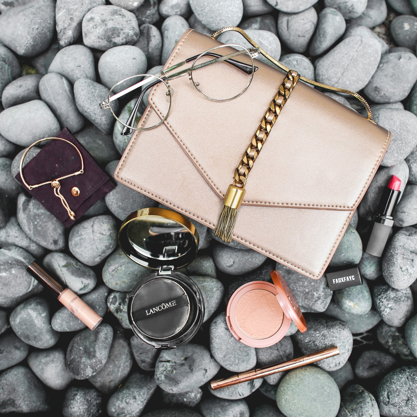 charles and keith rose gold bag, tarte amazonian clay blush, monica vinader, flatlay