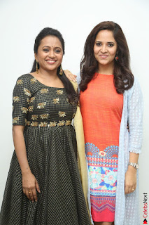 Actress Suma in Black Salwar Suit and Anusuya in orange Dress at winner movie press meet part 1 February 2017 (54).JPG