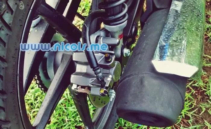 Tampilan rem cakram belakang New Supra X 125 FI 2014: Nissin caliper 1 piston