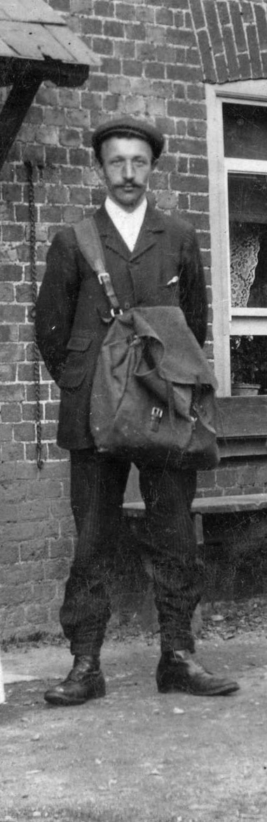 Photograph of Unknown postman outside The Woodman, Water End c1900 Peter Miller Collection