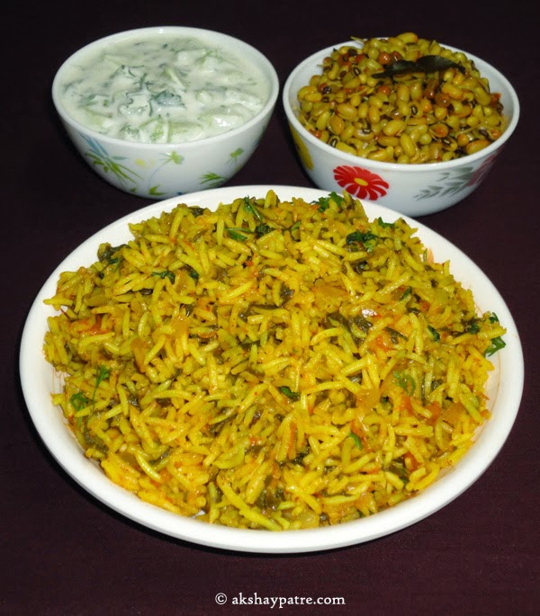 palak pulao with raita and usli in serving plate.
