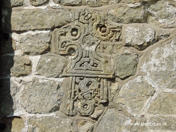 Ornate Scandinavian 'Jellinge' cross fragment in wall, St Hildas, Ellerburn