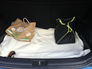 boot-of-car-its-two-bags-and-a-can-of-tango