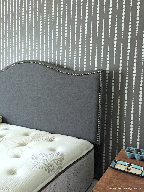 Master bedroom makeover with a new headboard and DIY stenciled wall