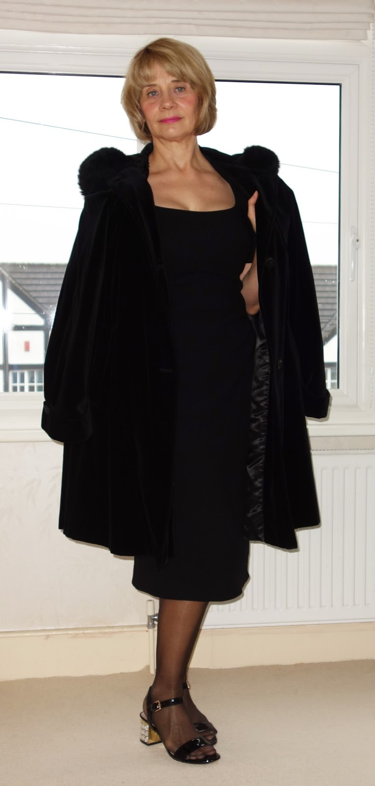 Black crepe figure flattering dress and black velvet coat