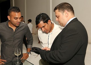 Guests observing the Jaeger-LeCoultre collection on display at the event