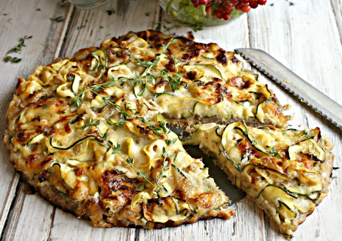Savory zucchini tart with fontina cheese in a buttery walnut crust.