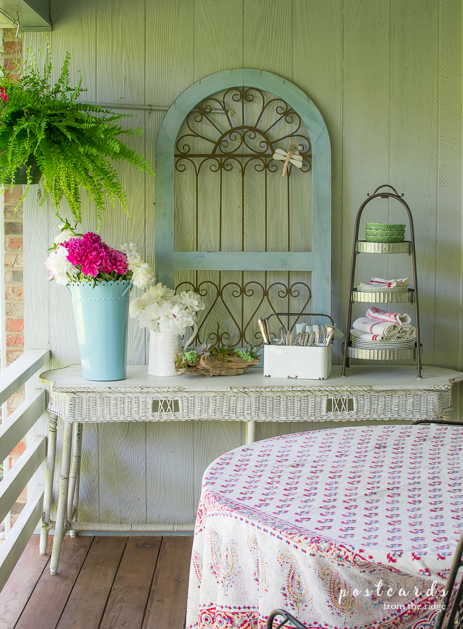 white wicker table with outdoor summer decor