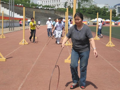 Hoop Rolling Pole Obstacle