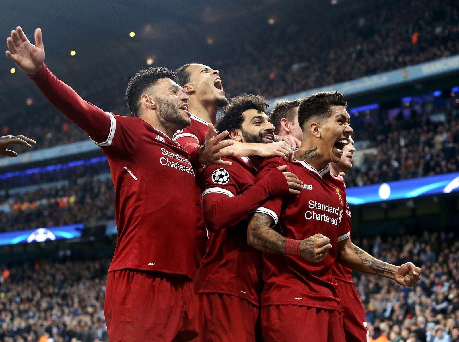 Liverpool players celebrating 5-2 win over Roma
