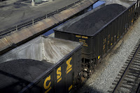 Coal in uncovered trains (Credit: AP Photo/Patrick Semansky) Click to Enlarge.