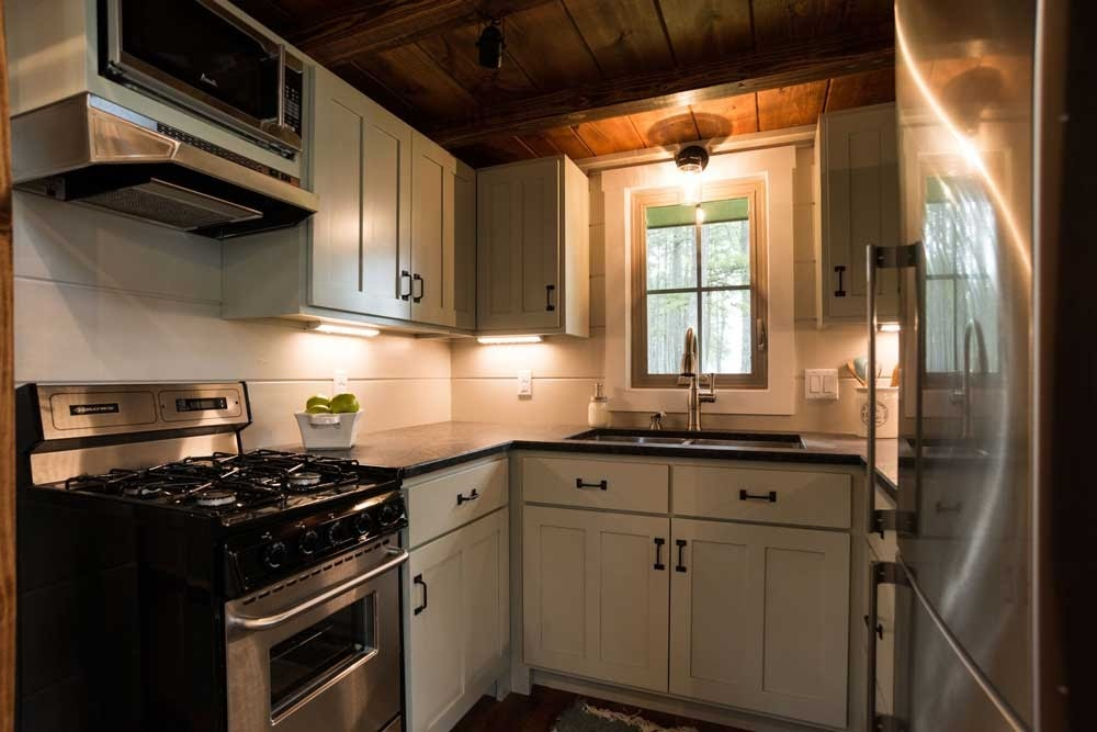 02-Kitchen-Timbercraft-Tiny-Homes-Architecture-with-Two-Double-Rooms-Tiny-House-www-designstack-co