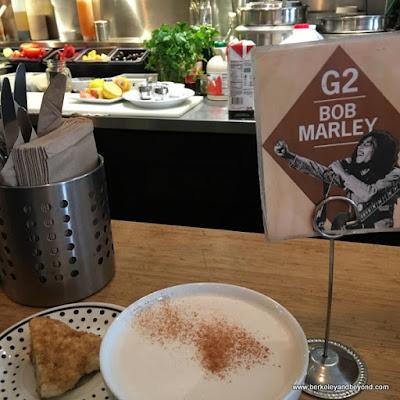 chai latte and mini scone at Guerilla Cafe in Berkeley, California