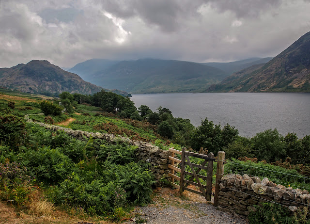 Photo of a gate in a stone wall at Crummock Water