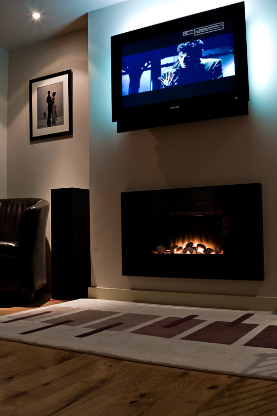 michael blanchard handyman services cozy up your home with a wall mounted fireplace. Black Bedroom Furniture Sets. Home Design Ideas