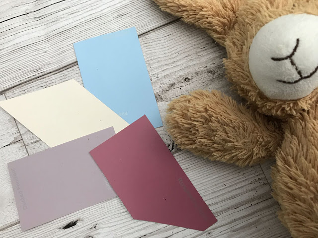 A flat lay of paint card samples and a bunny