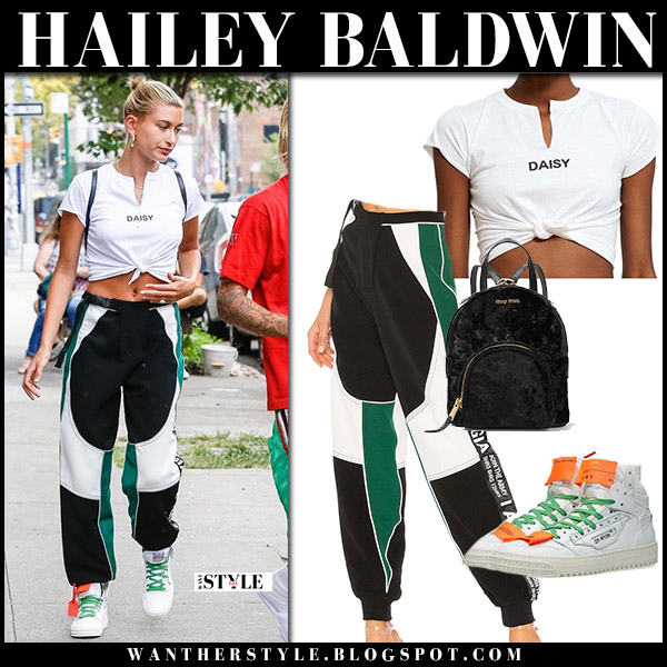 Hailey Baldwin with Justin in white crop top and black colour block pants i.am.gia model street fashion august 3