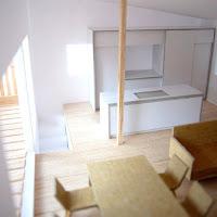広がりと開放感のあるワンルームを上下に重ねた住まい