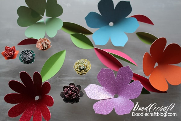 3D flowers made with DCWV cardstock doublesided and hot glued to each other.