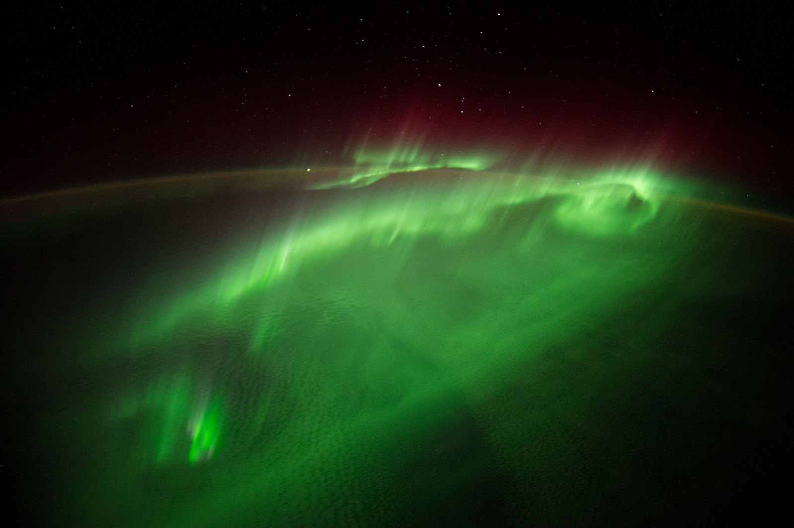 "Flying Through an Aurora Flying Through an Aurora   European Space Agency astronaut Alexander Gerst posted this photograph taken from the International Space Station to social media on Aug. 29, 2014, writing, ""words can't describe how it feels flying through an #aurora. I wouldn't even know where to begin….""  Crewmembers on the space station photograph the Earth from their unique point of view located 200 miles above the surface. Photographs record how the planet is changing over time, from human-caused changes like urban growth and reservoir construction, to natural dynamic events such as hurricanes, floods and volcanic eruptions. Crewmembers have been photographing Earth from space since the early Mercury missions beginning in 1961. The continuous images taken from the space station ensure this record remains unbroken.  On Tuesday, Sept. 9 aboard the space station, cosmonaut Max Suraev of Roscosmos takes the helm when Expedition 40 Commander Steve Swanson hands over control during a Change of Command Ceremony at 5:15 p.m. EDT. Suraev will lead Expedition 41 and stay in orbit until November with Gerst and NASA astronaut Reid Wiseman. Soyuz Commander Alexander Skvortsov, Swanson and Flight Engineer Oleg Artemyev will complete their mission Wednesday, Sept. 10 at 7:01 p.m. when they undock in their Soyuz TMA-12M spacecraft from the Poisk docking compartment for a parachute-assisted landing on the steppe of Kazakhstan a little less than 3.5 hours later.  Image Credit: NASA/ESA/Alexander Gerst Explanation from: http://www.nasa.gov/content/flying-through-an-aurora/"