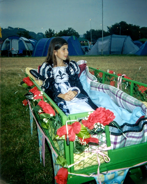 Girl in a festival trolley with flowers