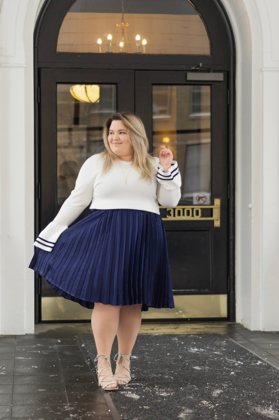 full figured fashion, natalie Craig, natalie in the city, plus size fashion blogger, Chicago plus size fashion blogger, embrace your curves, eff your beauty standards, plus size pleated midi skirt, bell sleeve sweater, affordable plus size clothing, eloquii, eloquii Chicago location
