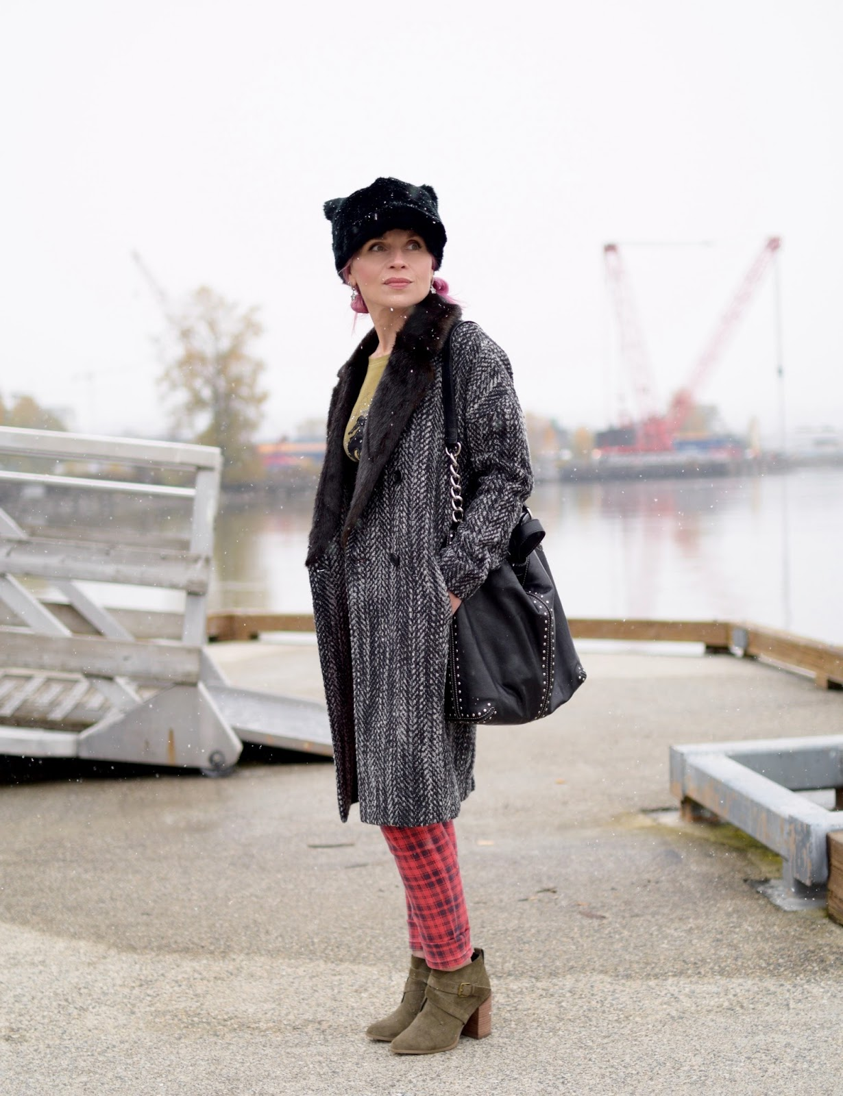 Monika Faulkner outfit inspiration - fur-collared coat, red plaid skinny jeans, olive ankle boots, and a hat with ears