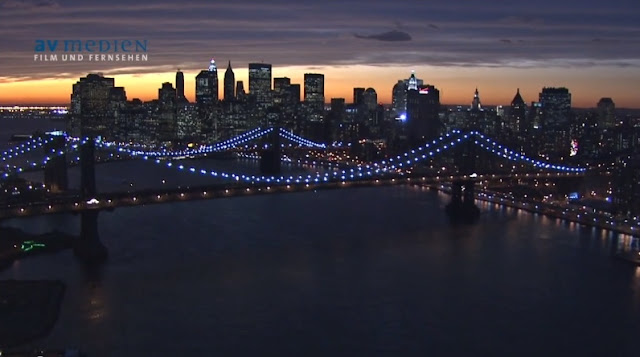 Photo of Manhattan bridge and Brooklyn Bridge at sunset