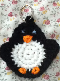 http://www.ravelry.com/patterns/library/crochet-penguin-keychain
