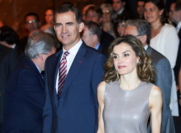 Queen Letizia attend 'La Caixa' Scholarship ceremony. Queen Letizia style, wore,MBUBAG clutch, Hugo Boss leather dress, Magrit sandals, Tous, mango earrings