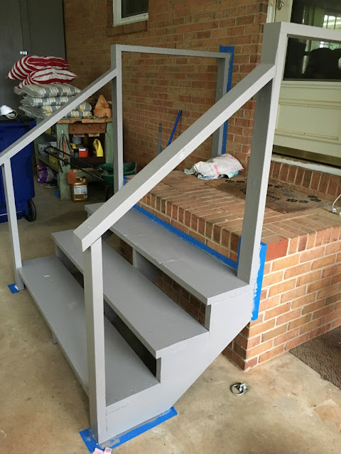 See what a difference paint made to our exterior stairs and side door!
