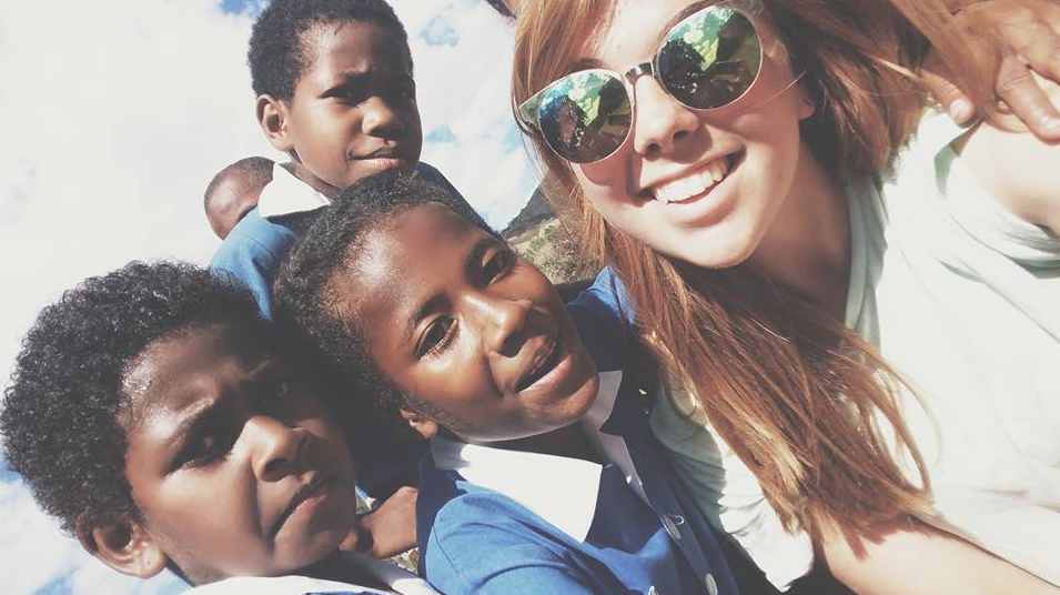 Catherine with the children in some village