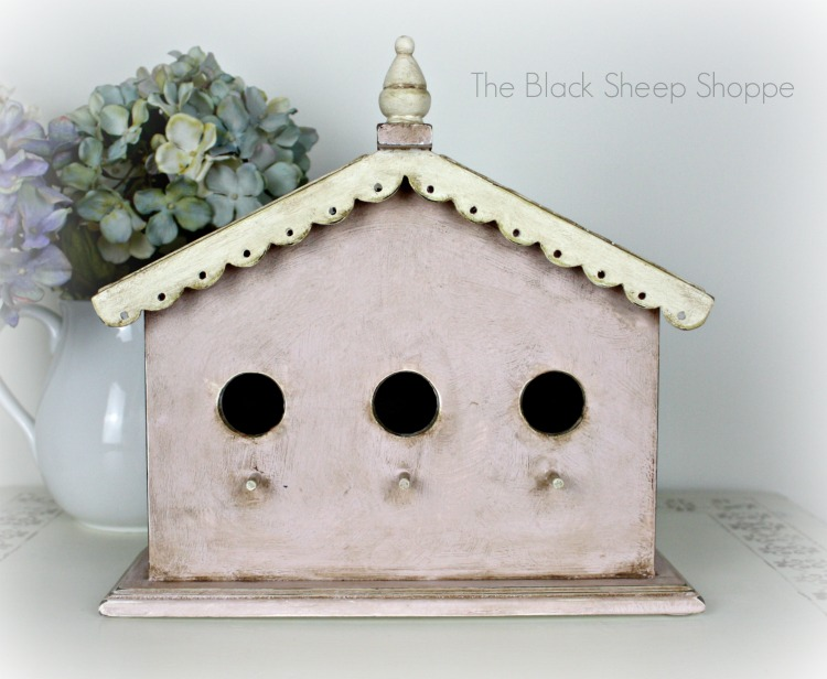 Pink and white birdhouse