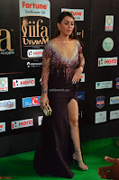 Hansika Motwani in Glittering Deep Neck Transparent Leg Split Purple Gown at IIFA Utsavam Awards 007.JPG