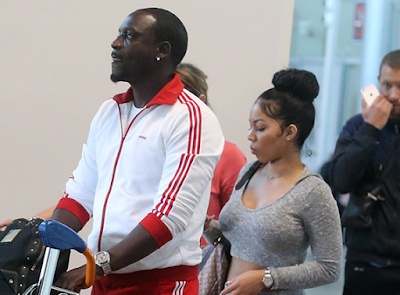 (Photos) Akon Pictured With One Of His Wives Stepping Out In France.