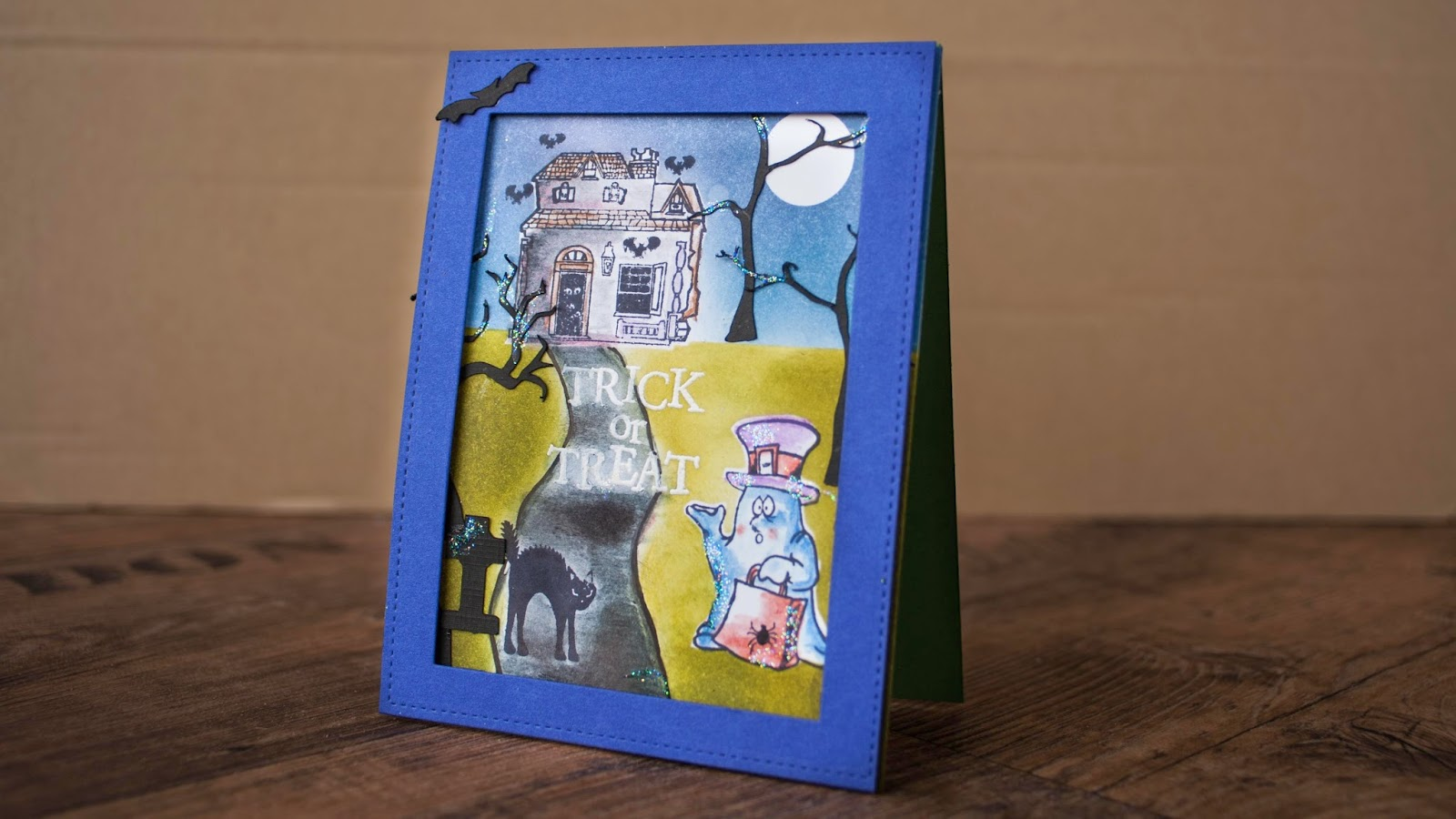 Halloween card #3 2014 - trick or treat the undecided ghost - and haunted house using distress inks and watercolor pencils