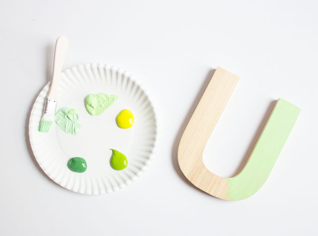 Paint wood letters to create this fun LUCKY banner craft for St. Patrick's Day!