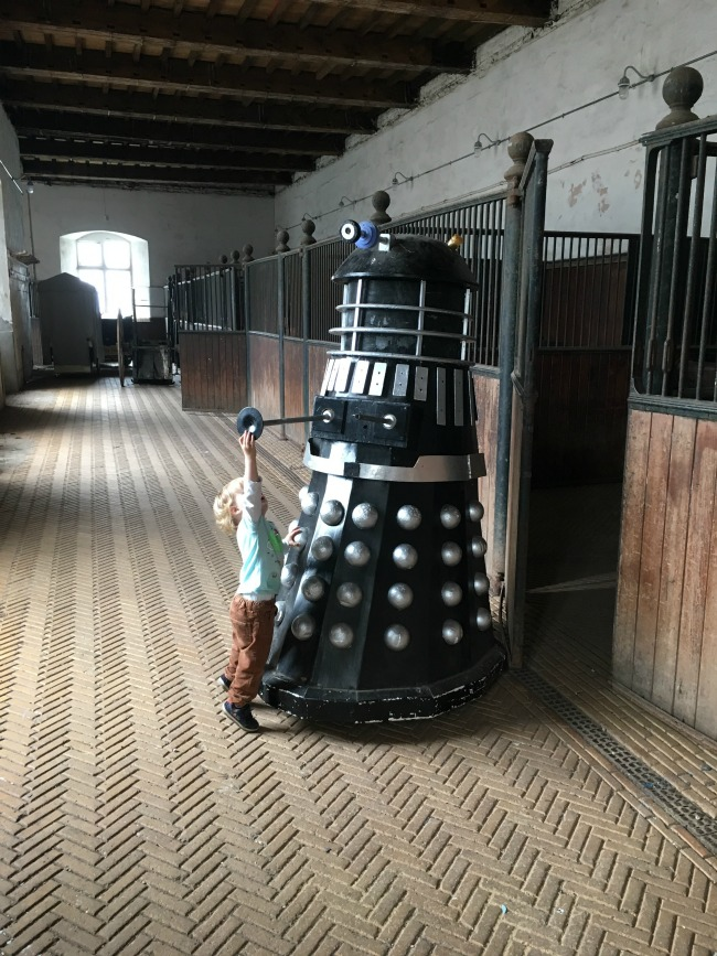 Tredegar-House-&-gardens-stables-with-toddler-touching-dalek