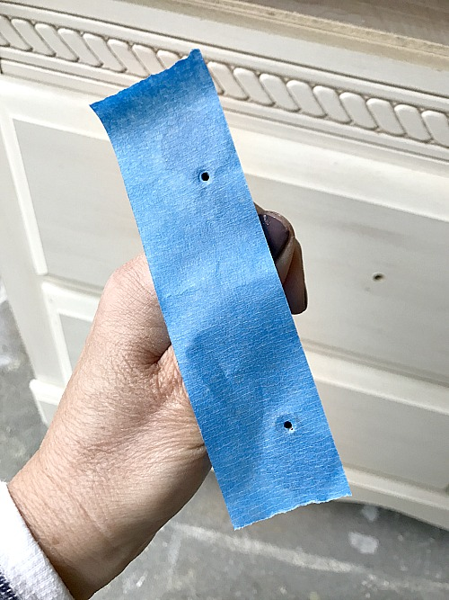 tape tip to find the hardware holes