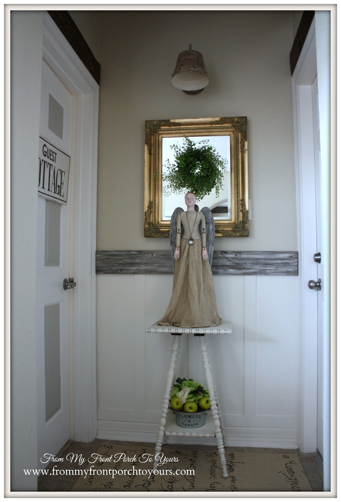 Guest Bedroom hallway decorated with a santos doll, wreath and vintage gold mirror at From My Front Porch To Yours.