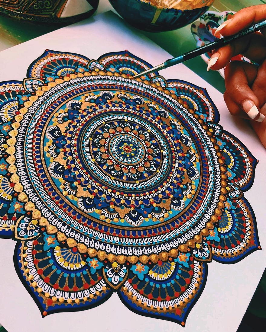01-Asmahan-Mosleh-Mandala-Drawn-and-then-Painted-with-Color-Themes-www-designstack-co