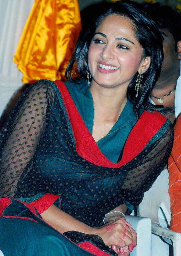 Anushka Shetty Smiling Face Photos In green Dress
