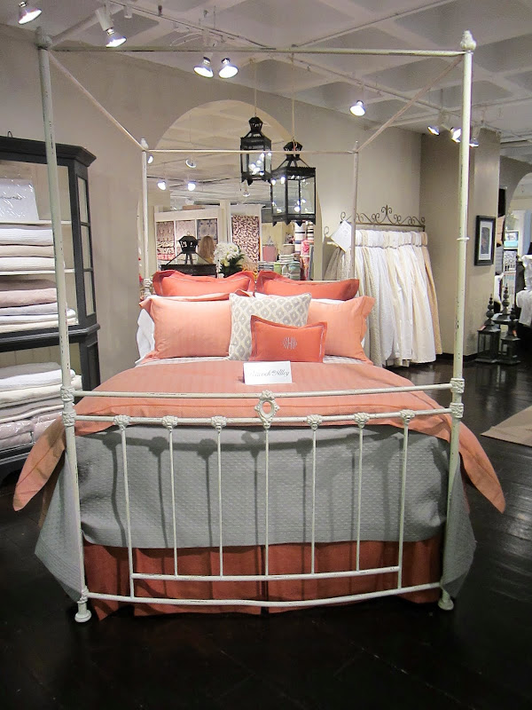 Coral and grey bed from Peacock Alley in a simple, white iron bedframe