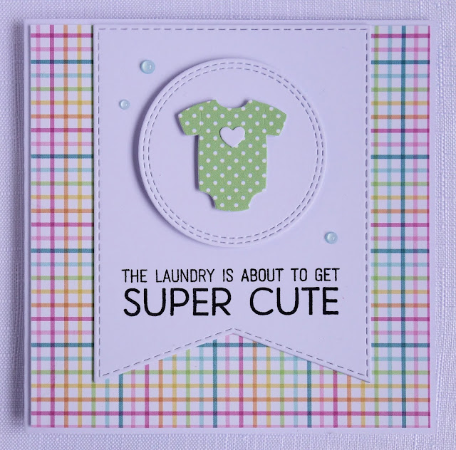 Handcrafted rainbow coloured baby shower card (using MFT bundle of baby clothes dienamics and welcome baby stamp set)