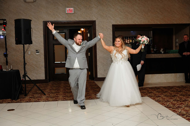 bride and groom entering italian american cultural center in clinton township