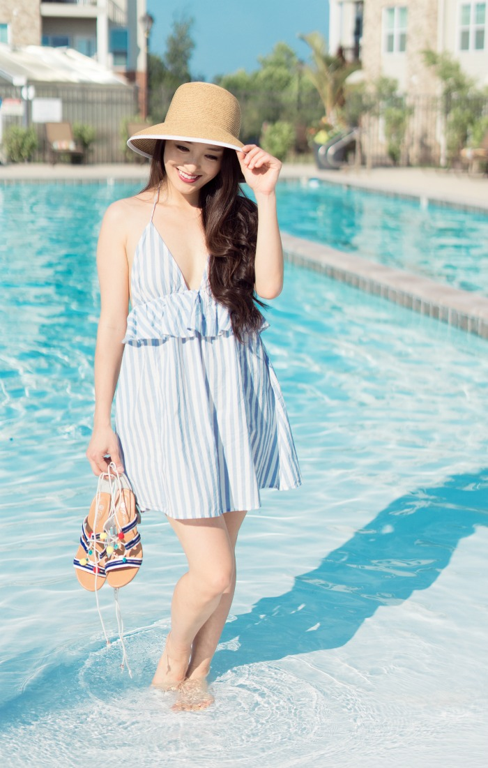 straw hat on fashion blogger