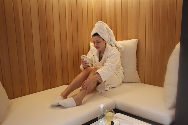 Eboni chilling in the Andaz Amsterdam Spa booths.