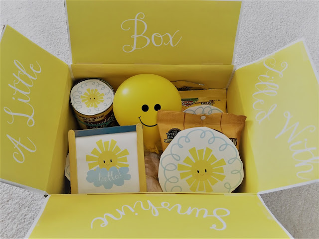 A Little Box Of Sunshine - A tutorial and free printables can be found to create this care package to help brighten someone's day. | sprinkledwithcolor.com