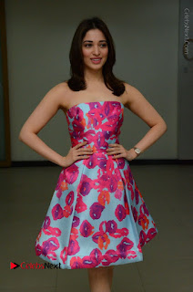 Actress Tamanna Latest Images in Floral Short Dress at Okkadochadu Movie Promotions  0046.JPG